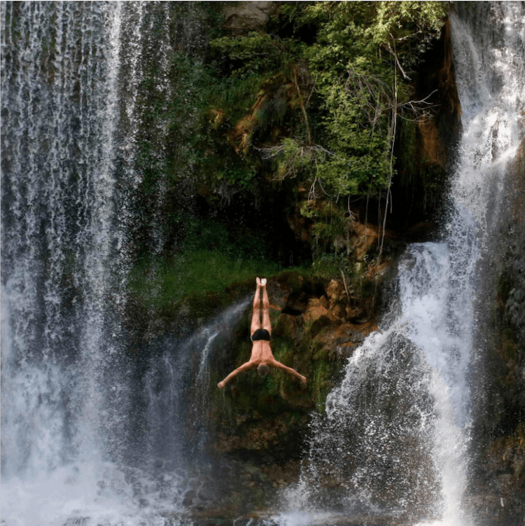 Diver in a water fall.